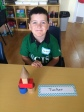 Tucker building with blocks during math exploration